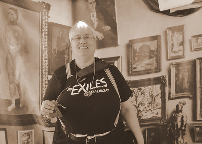 This woman stopped by proudly wearing her Exiles shirt. The Exiles meets below where the Mission Minyan gathers on Friday evenings inside the Women's Building. The Exiles are a non-profit educational group for women who have a positive personal interest in BDSM between women in San Francisco. The group provides educational events where women with all levels of experience will have a safe place to meet, explore and share information about safety, play techniques and resources, and connect with the leather community locally.
