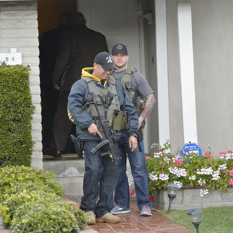. Police investigate the home of the mother of the alleged triple-murder Christopher Dorner in La Palma, California on February 8, 2013.