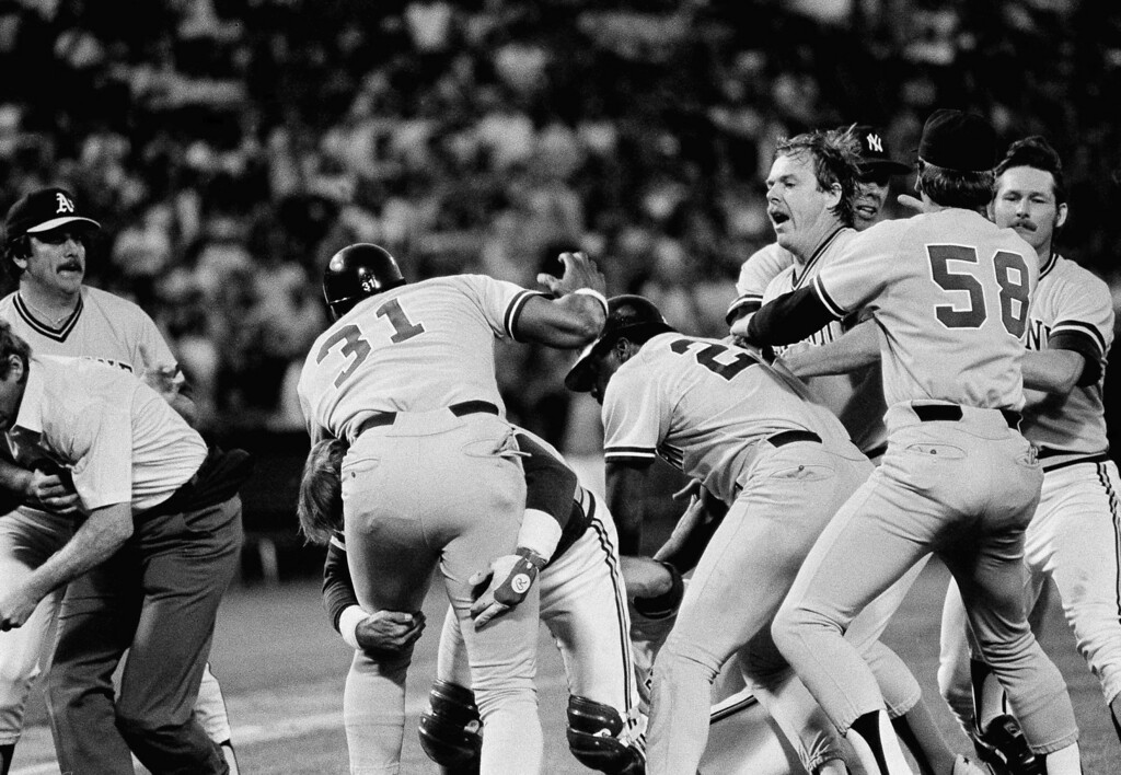 . Oakland A\'s and New York Yankees players hold back Yankees Dave Winfield (31), and A\'s pitcher Steve McCatty, right, after Winfield charged McCatty with a brush back pitch in the second inning, May 25, 1984 at the Oakland Coliseum. Both benches were emptied before they could get at each other. (AP Photo/Paul Sakuma)