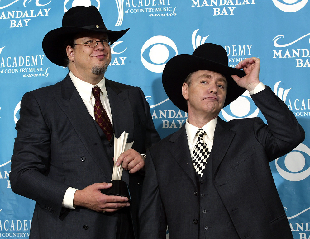 . ** FILE **  Pen Jillette, left, and Teller pose backstage at the 39th annual Academy of Country Music Awards in Las Vegas, in this May 26, 2004 file photo.  Penn & Teller will magically appear as hosts of the Creative Arts Emmy Awards, producer Spike Jones Jr. announced Tuesday, Aug. 1, 2006.  (AP Photo/Mark J. Terrill, File)