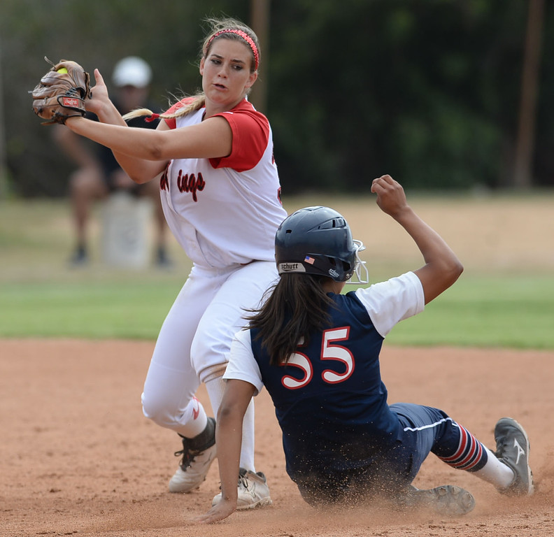 . Palos Verdes\' Kasey Halleen (34) tries to make the play on St. Paul\'s Myranda Bueno (55) at second in a CIF-SS Division III semifinal softball game Tuesday, May 27, 2014, Palos Verdes Estates, CA.   Palos Verdes lost 10-0. Photo by Steve McCrank/Daily Breeze