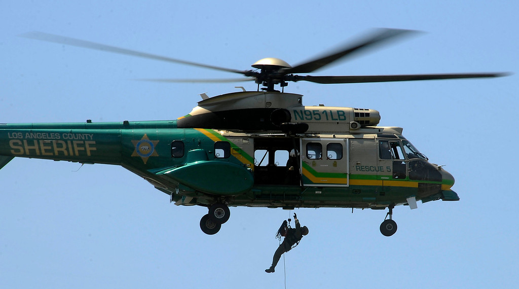 . LA county sheriff air rescue 5 performs a air lift rescue during the 20th anniversary of American Heroes Air Show Courage at the Speed of Flight at Hansen Dam. Lake View Terrace CA.  June 29,2013. Photo by Gene Blevins/LA Daily News
