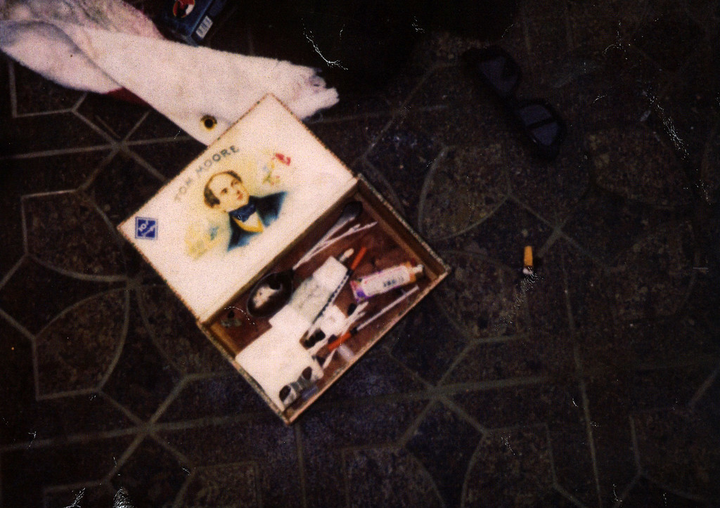 . This April 1994 photo provided by the Seattle Police Department shows items found at the scene of Kurt Cobain\'s suicide, in Seattle. The image has never before been released. Police spokeswoman Renee Witt said Thursday, March 20, 2014, that several rolls of undeveloped film were found when a detective re-examined the Cobain case recently. (AP Photo/Seattle Police Department)