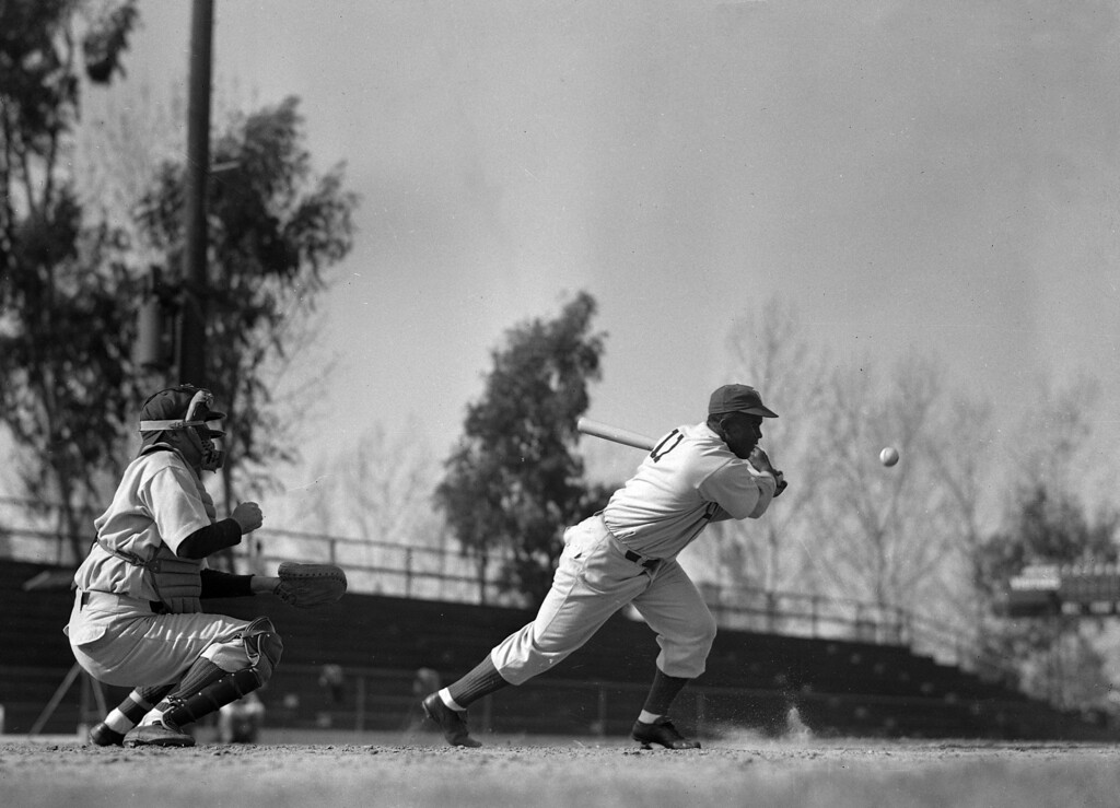 Description of . JACKIE ROBINSON FILM 1950  Jackie Robinson swings and hits during a scene in the film of his career, Feb. 20, 1950, in Anaheim, California.  (AP Photo/Frank Filan)