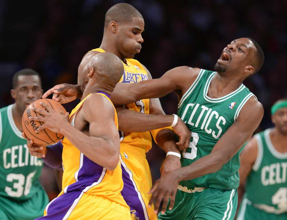 . Lakers Kobe Bryant and Antawn Jamison battle Celtics\' Jeff Green during first half action at Staples Wednesday.  Photo by David Crane/Staff Photographer