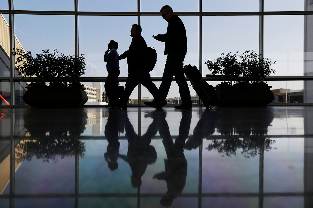 . Travelers pass through a corridor at Philadelphia International Airport, Thursday, Feb. 14, 2013, in Philadelphia. (AP Photo/Matt Rourke)