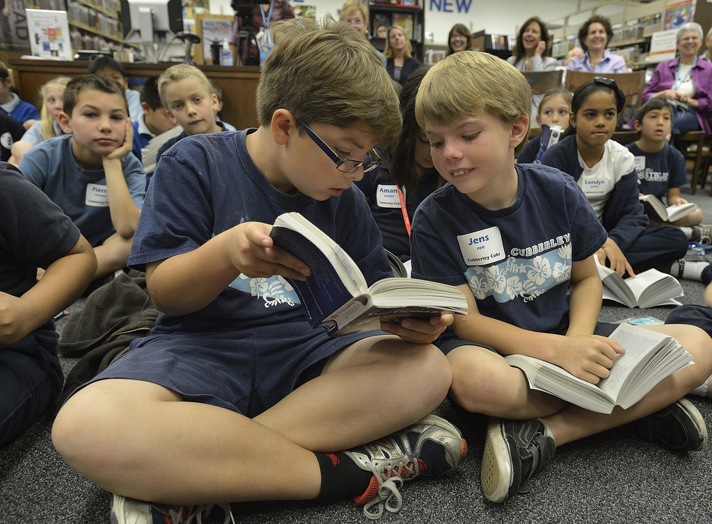 """. LONG BEACH, CALIF. USA -- Cubberley third graders Brandon Fox, left, and Jens Ree look up a word during a game at the El Dorado Beach Library in Long Beach, Calif., on February 28, 2013. This is the 10th. year that dictionaries have been purchased and distributed to third-grade students in the Long Beach Unified School District, charter, local parochial and private schools. The Long Beach Dictionary Project promotes literacy and the goal that all students will leave third-grade at the end of the year as \""""good writers, active readers, and creative thinkers\"""". The Miller Foundation, which has been providing dictionaries to third-graders since 2003, is celebrating giving away its 100,000 lexicon literary.  Photo by Jeff Gritchen / Los Angeles Newspaper Group"""