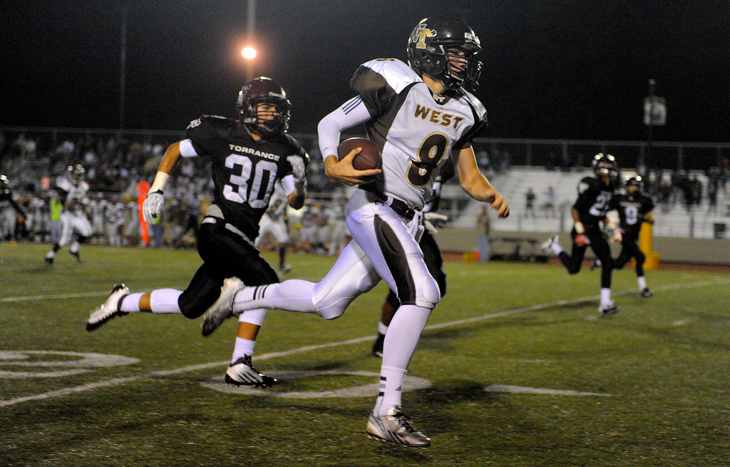 . West High takes on Torrance in a non league football game at Zamperini Stadium in Torrance, CA on Thursday, September 12, 2013. West won 46-7. West\'s #8 had this long TD run called back due to a holding penalty. (Photo by Scott Varley, Daily Breeze)