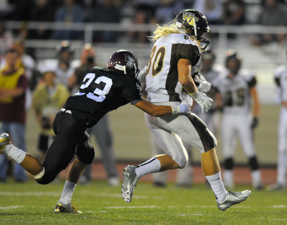 . West High takes on Torrance in a non league football game at Zamperini Stadium in Torrance, CA on Thursday, September 12, 2013. West\'s Craig Knaus is stopped by Sam Hudson after a gain. (Photo by Scott Varley, Daily Breeze)