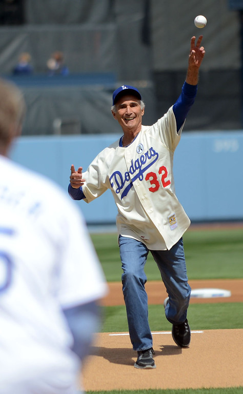 . Sandy Koufax throws out the first pitch on opening day at Dodger Stadium April 1, 2013.  The Dodgers hosted the San Francisco Giants.(Andy Holzman/Staff Photographer)