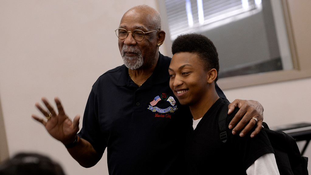 Description of . Olympian John Carlos speaks poses for pictures with student and athlete Jamal Williams at San Bernardino High School February 27, 2013.  GABRIEL LUIS ACOSTA/STAFF PHOTOGRAPHER.