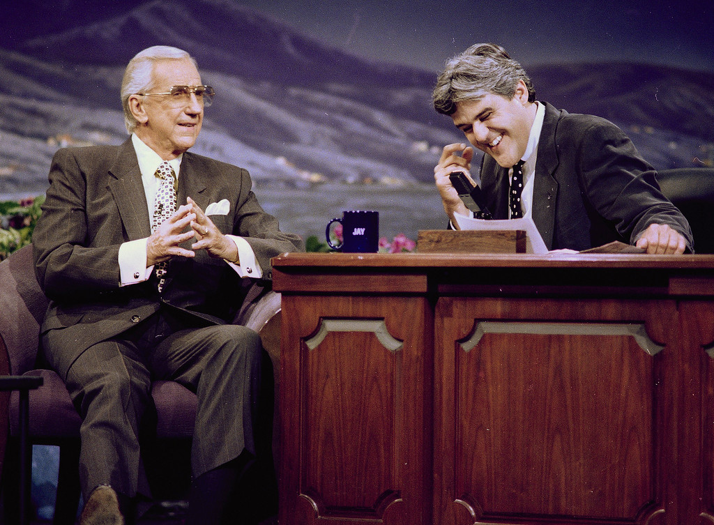 ". Ed McMahon, left, former announcer of the ""Tonight Show,\"" looks on as \""Tonight Show\"" host Jay Leno breaks into laughter during the taping of the show, July 30, 1993, in Burbank, Calif.  This was McMahon\'s first appearance on the show since the departure of Johnny Carson.  (AP Photo/Kevork Djansezian)"