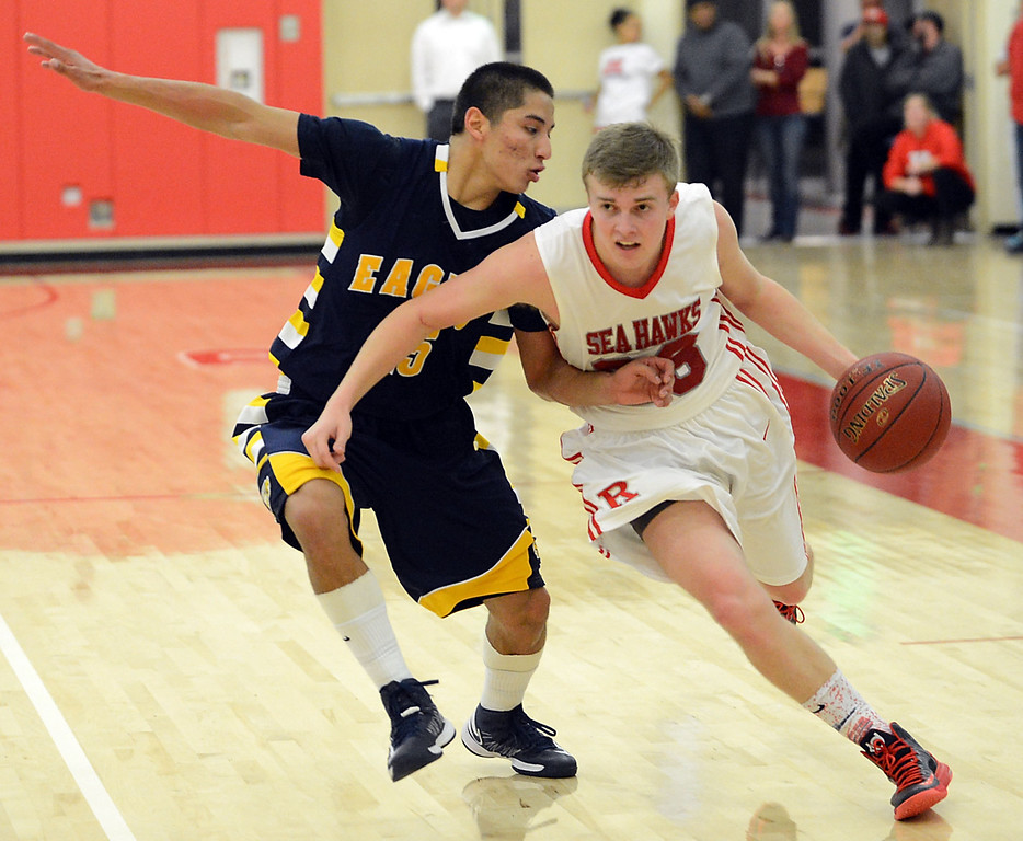 . Redondo Union\'s Derek Biale (23) drives down court against Arroyo Grande\'s Matt Willkomm (15) in a CIF Southern Section Division II-A semifinal boys basketball game Tuesday night in Redondo Beach. 20130226 Photo by Steve McCrank / Staff Photographer