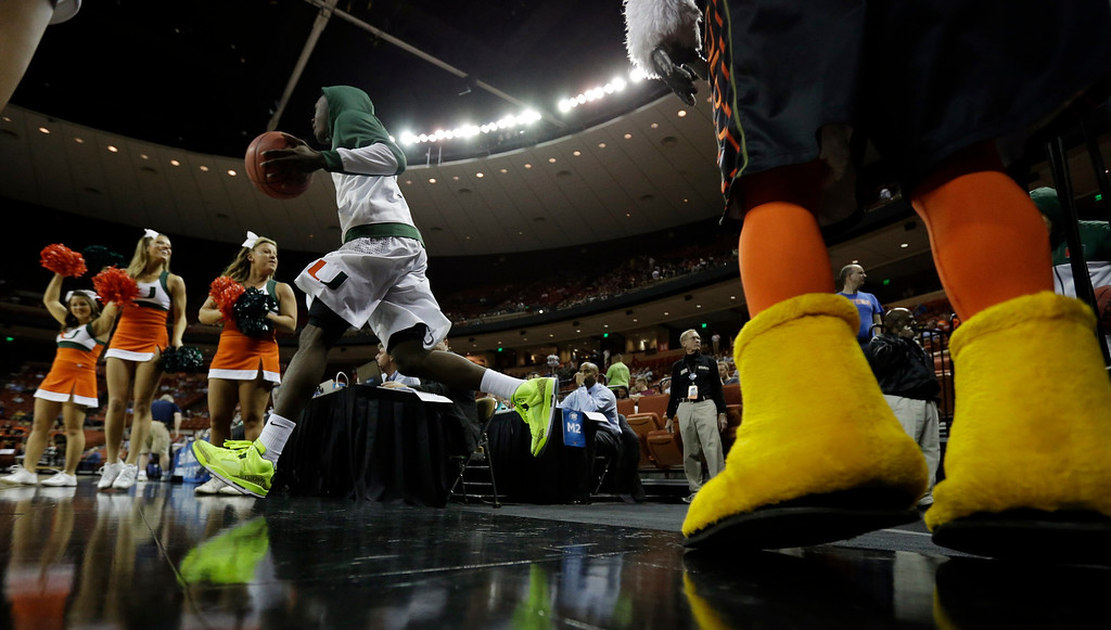 . A Miami player takes the court before the first half of a second-round game of the NCAA college basketball tournament against the Pacific Friday, March 22, 2013, in Austin, Texas.  (AP Photo/Eric Gay)