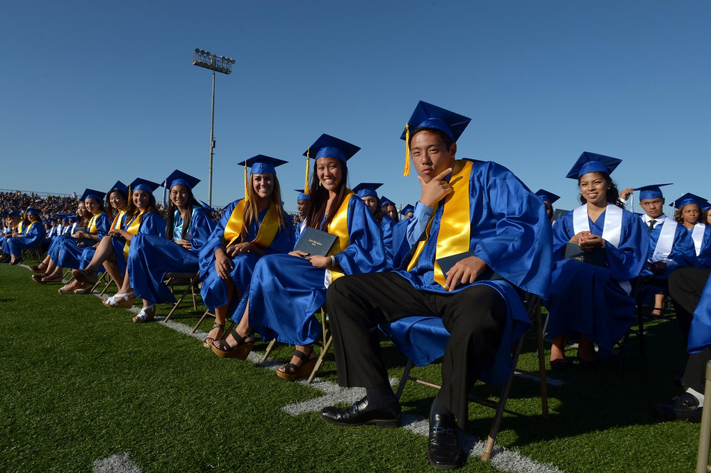 . From right, Daniel Hong, Samantha Horito, Haily Huff and Kayla Igawa wait for ceremonies to begin. The 2013 North High School commencement ceremonies take place on the school\'s football field in Torrance Wednesday afternoon.