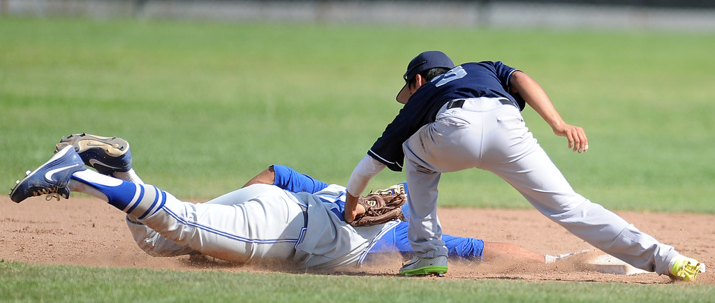 Description of . Duarte's Pablo Lopez (C) (3) tags out Charter Oak's Zo Carrillo at second base in the sixth inning of the Championship game of the Gladstone Baseball Tournament at Gladstone High School on Wednesday, April 3, 2013 in Covina, Calif. Charter Oak won 5-3. (Keith Birmingham Pasadena Star-News)