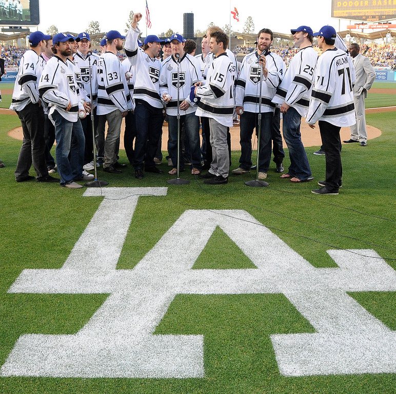 """. Members of the Kings announce that \""""Its Time for Dodger Baseball.\"""" Before the game the Los Angeles Kings brought the Stanley Cup to the field to show it off for the crowd and pose for photos with members of the Dodgers and Angels.  The Dodgers hosted the Los Angeles Angels of Anaheim in a game played at Dodger Stadium. Los Angeles, CA 6/13/2012(John McCoy/Photographer)"""