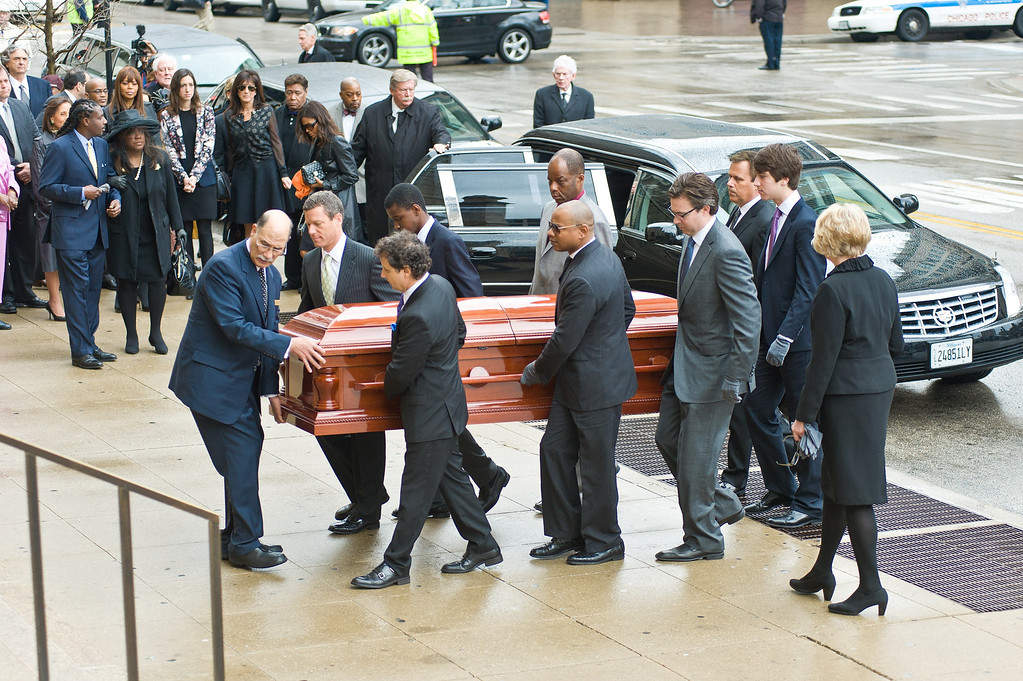 . CHICAGO, IL - APRIL 08:  Pall Bearers carry the coffin of Roger Ebert at the funeral services for Roger Ebert at Holy Name Cathedral on April 8, 2013 in Chicago, Illinois.  (Photo by Timothy Hiatt/Getty Images)