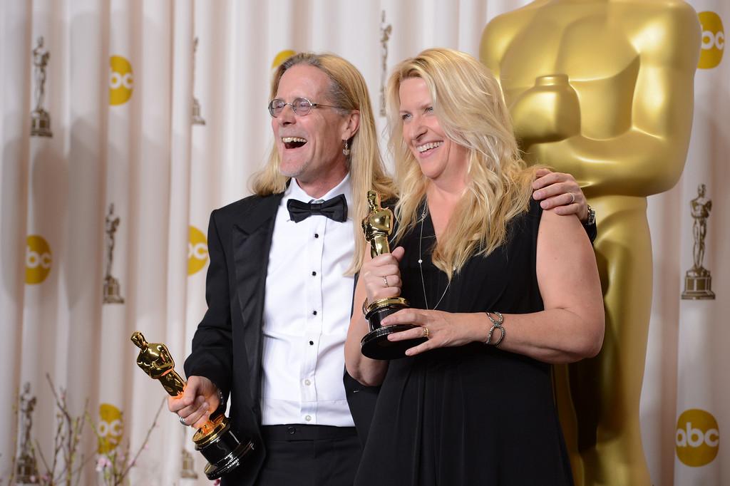 Description of . Per Hallberg and Karen Baker Landers accept the award for best sound editing for