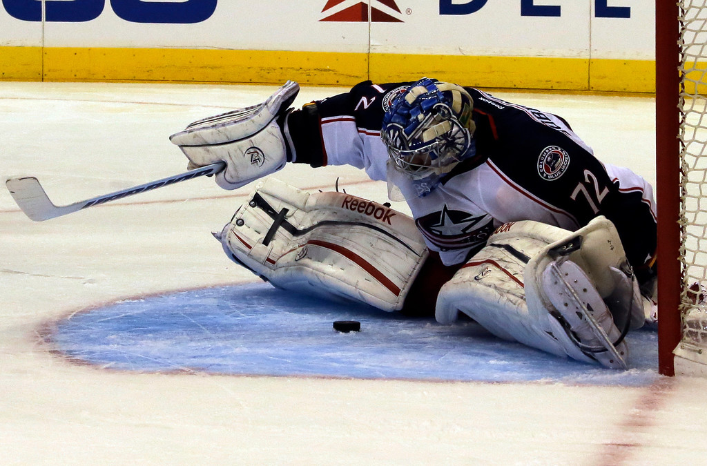 . Columbus Blue Jackets goalie Sergei Bobrovsky blocks a shot on goal in the second period of an NHL hockey game in Los Angeles Thursday, April 18, 2013. (AP Photo/Reed Saxon)
