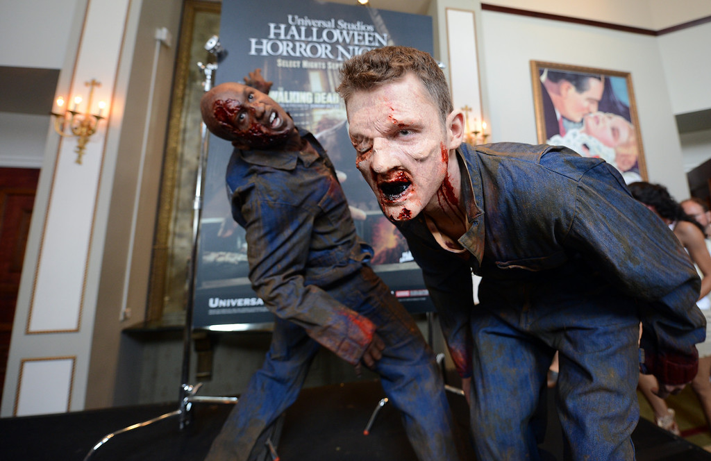 . Walking Dead zombies pose for the cameras during a press preview of Universal Studios \'Halloween Horror Nights� at Universal Studios Tuesday, August 27, 2013. \'Halloween Horror Nights� begins on Friday, September 20, and continues on 21 select nights through November 2, 2013. (Hans Gutknecht/Los Angeles Daily News)