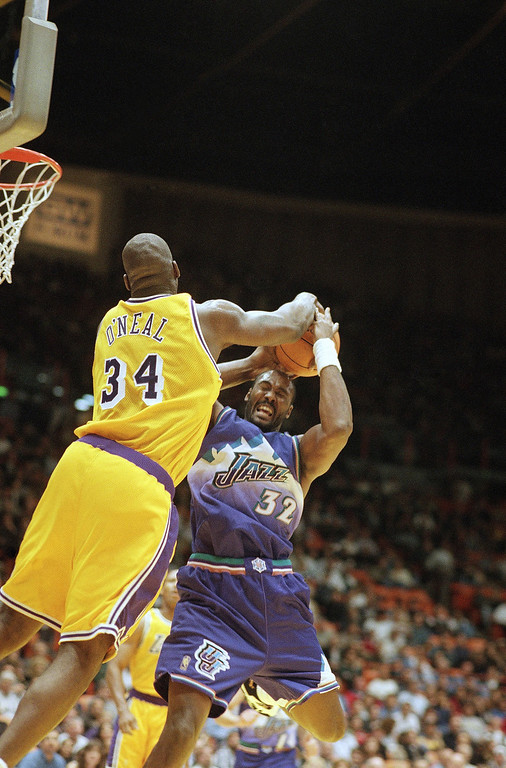 . Shaquille O?Neal of the Los Angeles Lakers, left, blocks the shot of Karl Malone of the Utah Jazz during the first half of their game on Wednesday, Nov. 20, 1996 in Inglewood, California. (AP Photo/Mark J. Terrill)