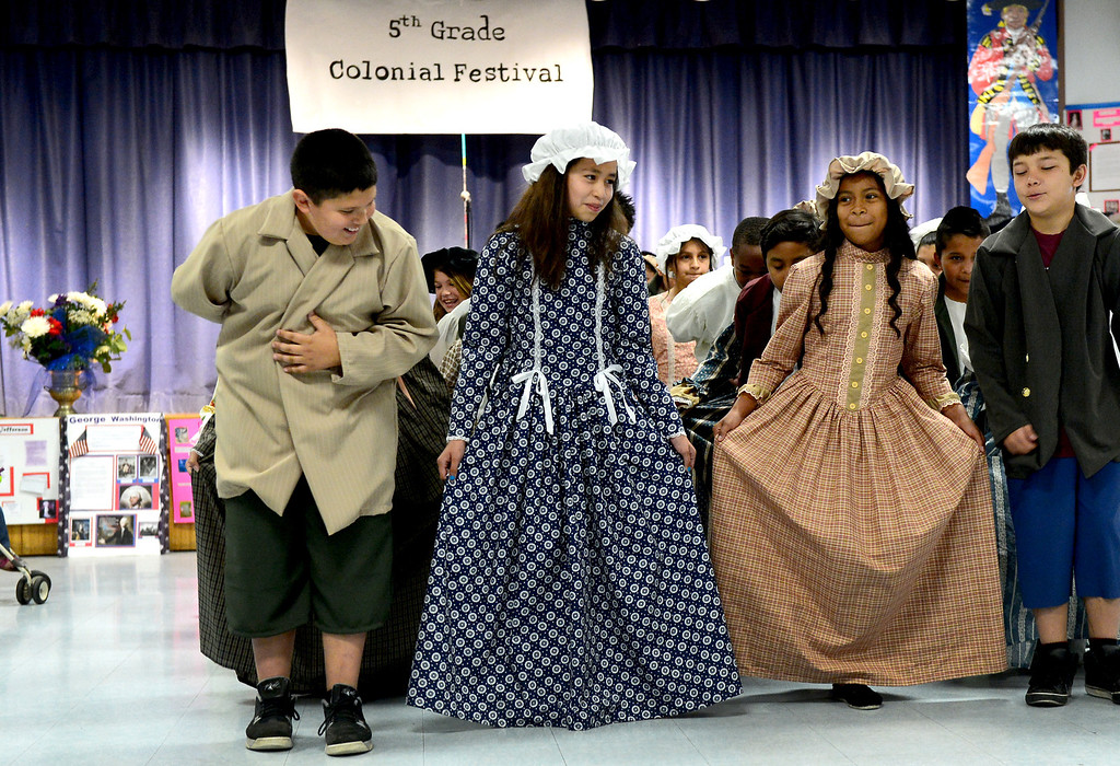 Description of . Tracy Elementary School fifth-graders do the Minuet during a Colonial Festival Tuesday morning, March 26, 2013 at the Baldwin Park school. In one month the students completed a report, learned two songs and two dances. Grecia Herrera, the school's nutritional aid, made the dresses and boys' suits. (SGVN/Staff Photo by Sarah Reingewirtz)