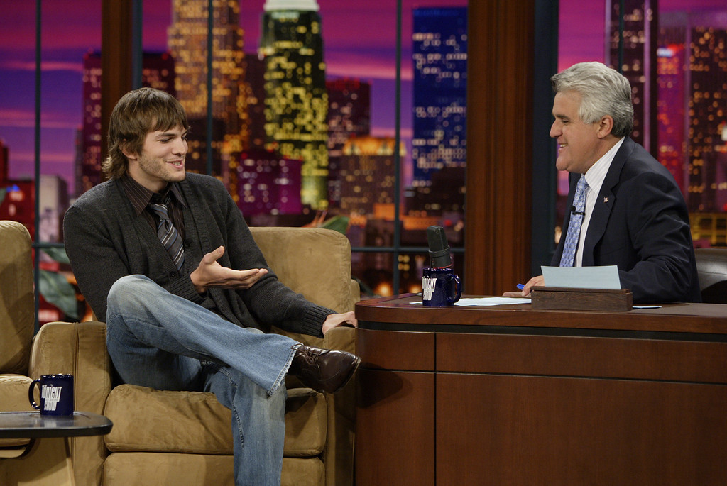 ". In this photo provided by NBC Universal,  Ashton Kutcher  talks with host Jay Leno, right, during a taping of the ""Tonight Show with Jay Leno,\"" Thursday, Sept. 28, 2006, in Burbank, Calif. (AP Photo/NBC UNIVERSAL/Paul Drinkwater) ** NO SALES **"