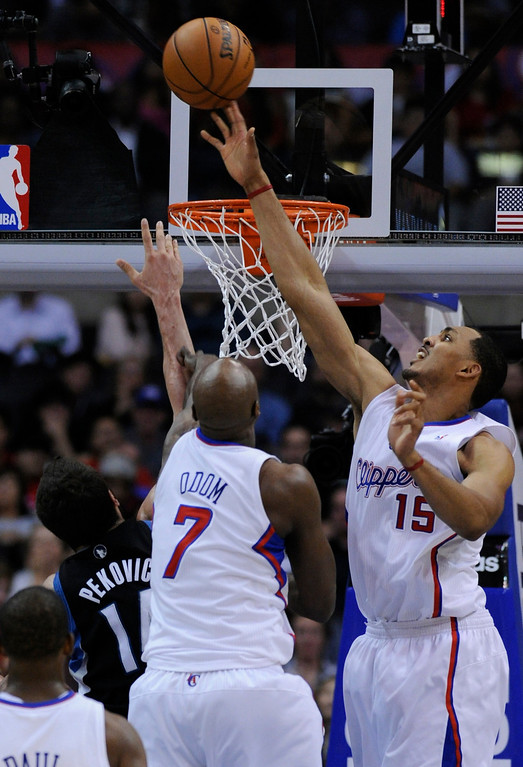 . Clippers#15 Ryan Hollins and Clippers#7 Lamar Odom block a shot by Timberwolves#14 Nikola Pekovic. The Clippers defeated the Minnesota Timberwolves 111-95 in a game played at Staples Center in Los Angeles, CA 4/10/2013(John McCoy/Staff Photographer