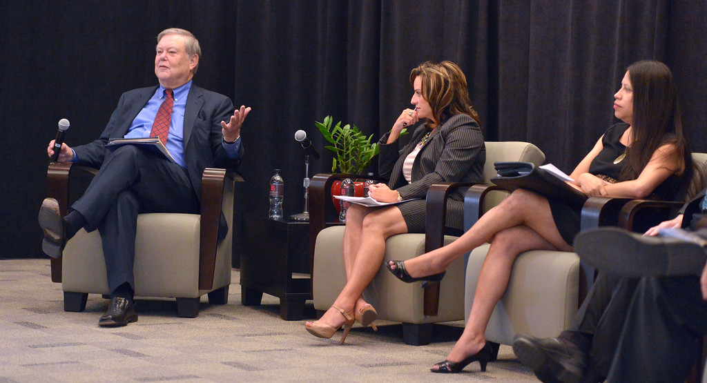 . Patrick Callan, left, moderates a forum to discuss report on higher education at Long Beach City College on Wednesday, April 30, 2014. Panel members in the forum included Lou Anne Bynum, center, and Alma Salazar, right. (Photo by Scott Varley, Daily Breeze)