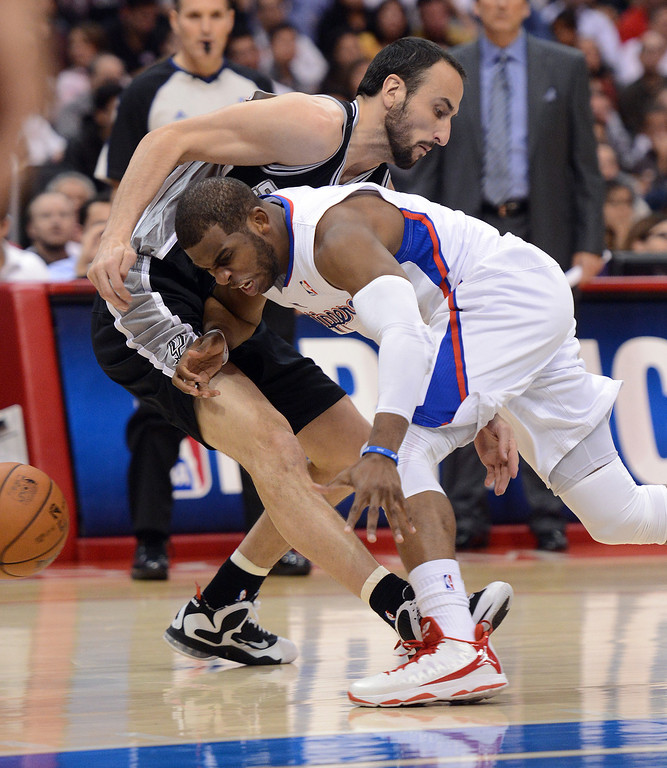 . The Clippers\' Chris Paul #3 draws the offensive foul on the Spurs\' Manu Ginobili #20 during their game at the Staples Center in Los Angeles Friday, February  21, 2013. The Spurs beat the Clippers 116-90. (Hans Gutknecht/Staff Photographer)