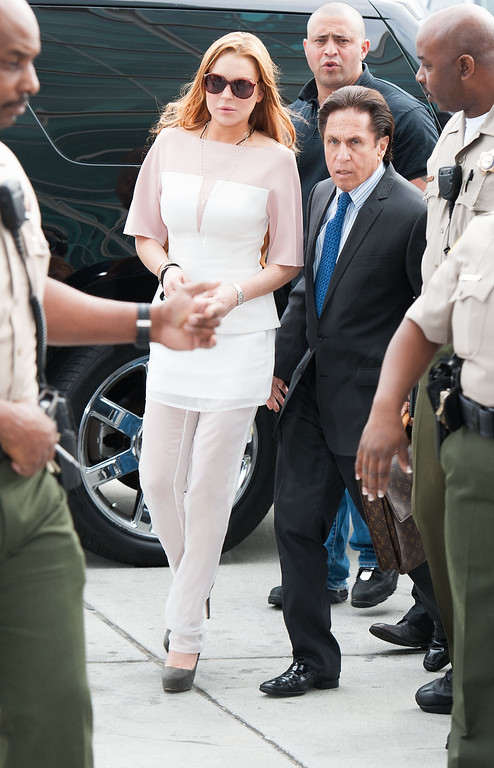 . LOS ANGELES, CA - MARCH 18:  Lindsay Lohan (L) and her lawyer Mark Heller arrive to Lohan\'s trial for allegedly lying to police after a car crash, reckless driving and violating her probation for a 2011 jewelry theft conviction at Airport Branch Courthouse of Los Angeles Superior Court March 18, 2013 in Los Angeles, California.  If convicted Lohan could serve the remainder of her 245 day suspended sentence for her jewelry theft conviction.  (Photo by Valerie Macon/Getty Images)