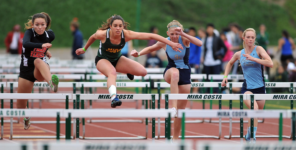 . 3/30/13 - Julianna Lioloa of Mira Costa High School wins her heat of the girls 100 meter hurdles, varsity,  at the Mustang Relays track and field events at Mira Costa High School on Saturday morning. Photo by Brittany Murray / Staff Photographer