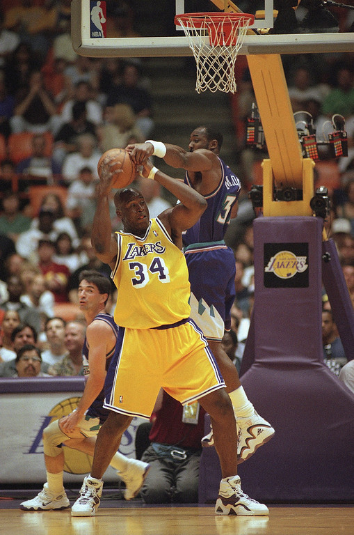 . Utah Jazz forward Karl Malone, right, knocks the ball loose from Los Angeles Lakers center Shaquille O?Neal (34) while Malone?s teammate John Stockton looks on during the game, Sunday, April 19, 1998 in Inglewood, California. O?Neal scored 33 points to lead the Lakers over Utah, 102-98. (AP Photo/Mark J. Terrill)