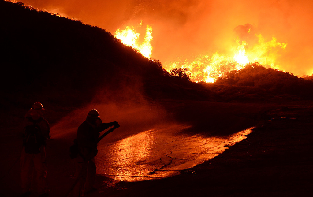 . Firefighters continue battling the Powerhouse Fire as the blaze enters its fourth day early Sunday, June 2, 2013, in the Angeles National Forest near the Lake Hughes area. (Gene Blevins/L.A. Daily News)
