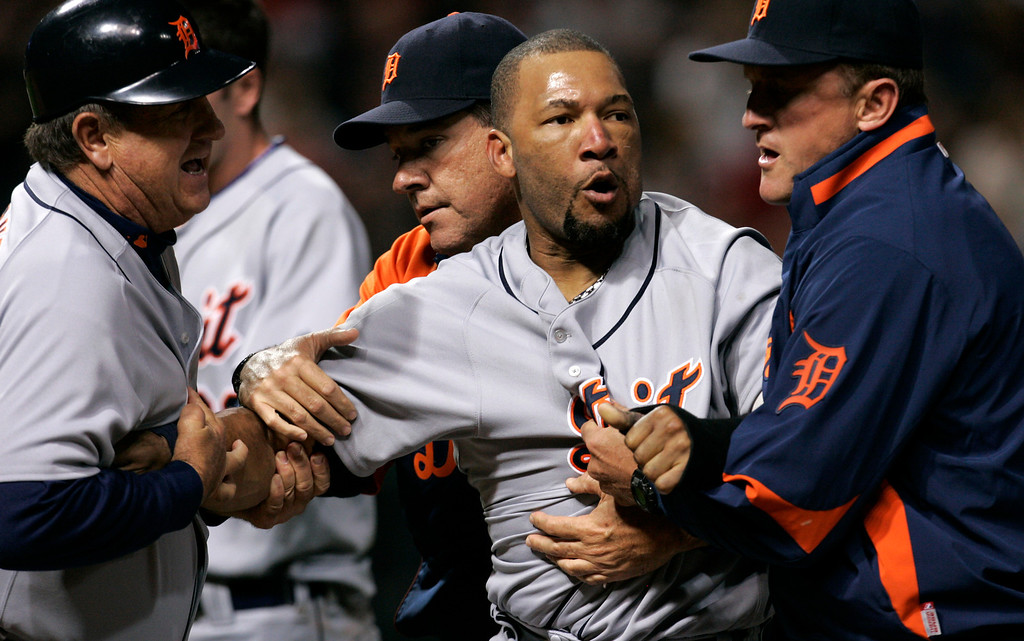 . Detroit Tigers\' Gary Sheffield, center, is escorted off the field by teammates after a during a benches clearing brawl in the seventh inning of a baseball game against the Cleveland Indians, Friday, Sept. 19, 2008, in Cleveland. (AP Photo/Tony Dejak)