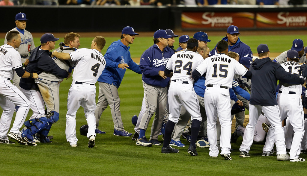 . San Diego Padres catcher Nick Hundley, left, restrains Los Angeles Dodgers catcher A.J. Ellis during a brawl between the two teams that occurred when Los Angeles Dodgers pitcher Zack Greinke hit batter Carlos Quentin with a pitch in the sixth  inning of baseball game in San Diego, Thursday, April 11, 2013. (AP Photo/Lenny Ignelzi)