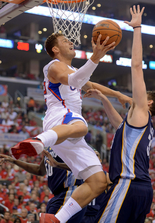. Clippers forward Blake Griffin makes a move under the hoop against the Memphis Grizzlies during game 2 of the 2013 NBA Western Conference Playoffs April 22, 2013 in Los Angeles, CA.(Andy Holzman/Staff Photographer)