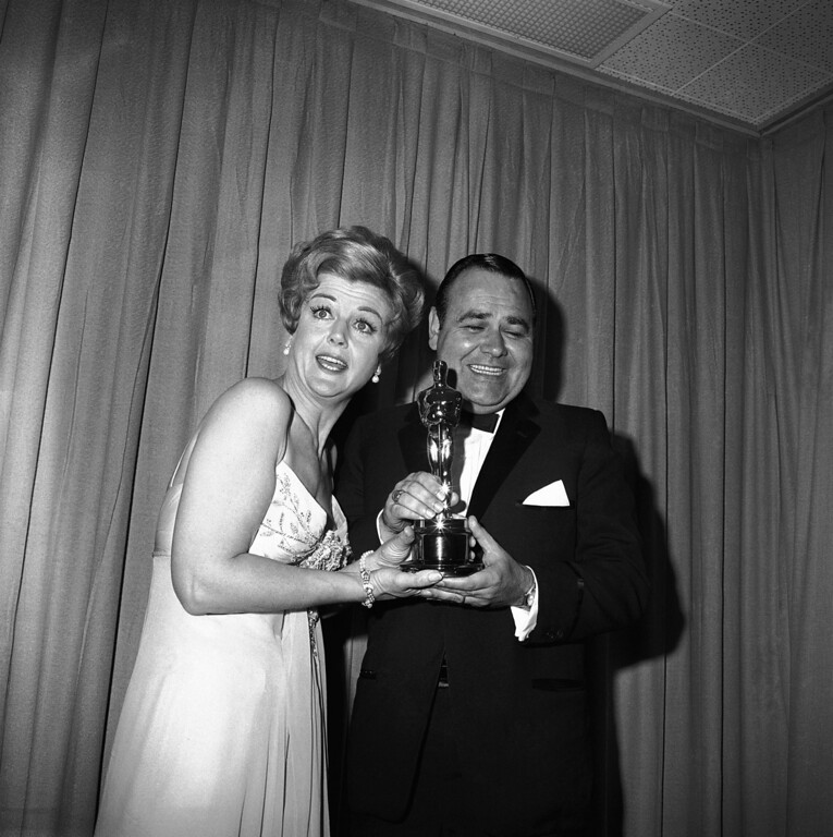 . Comedian Jonathan Winters accepts Oscar won by Peter Ustinov as best supporting actor of the year, presented by actress Angela Lansbury, April 5, 1965. Ustinov won for his role in ?Topkapi.? (AP Photo)