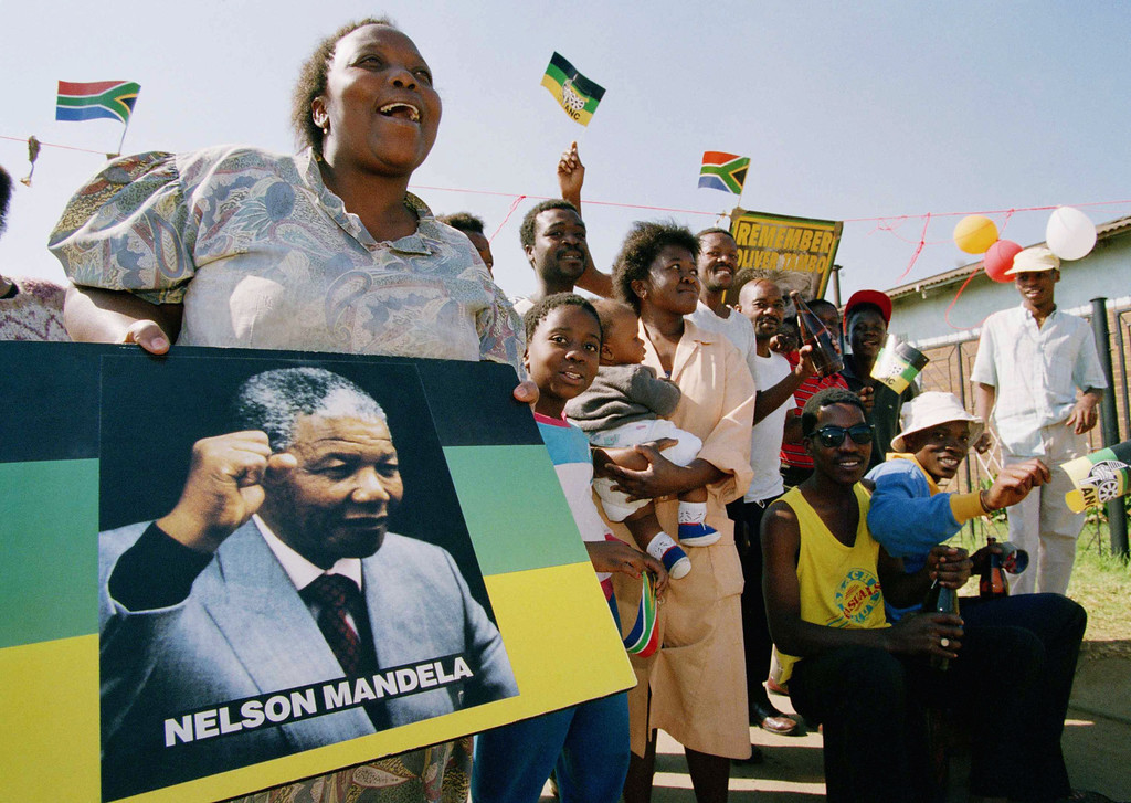 . Soweto residents celebrate as President-elect Nelson Mandela was sworn in as South Africa\'s first black president at an inauguration ceremonies in Pretoria, May 10, 1994. (AP Photo/Joao Silva)