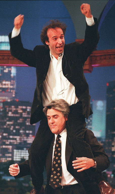 ". Italian comedian Roberto Begnini gets a ride on the shoulders of late night talk show host Jay Leno during taping of ""The Tonight Show\"" at the NBC studios in Burbank, Calif., Thursday, April 18, 1996. (AP Photo/The Tonight Show)"
