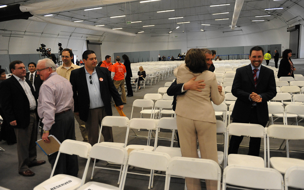 . A few hugs and handshakes between SCIG supporters after the EIR is approved by the LA Harbor Commission during meeting to determine the fate of the SCIG rail terminal, or Southern California International Gateway.    Photo by Brad Graverson 3-7-13