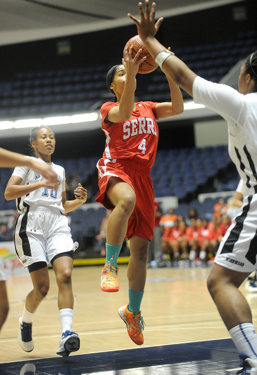 . 02-27-2012--(LANG Staff Photo by Sean Hiller)- Serra vs. Windward in Wednesday\'s girls basketball CIF SS Div. 4AA title game at the Anaheim Convention Center Arena in Anaheim. Serra\'s Deandrea Toler (4) is stopped by Windward\'s Kristen Simon (55).