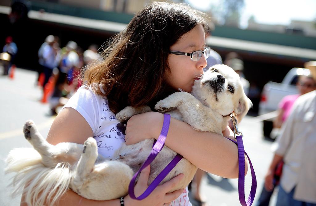 Description of . Fifteen year-old Marissa Camerano kisses her dog