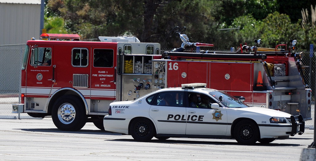 . Los Angeles City Fire personnel and campus police drive around the campus after a bomb threat closed the campus of Cal State Los Angeles on Thursday, April 18, 2012 in Los Angeles, Calif.    (Keith Birmingham/Pasadena Star-News)