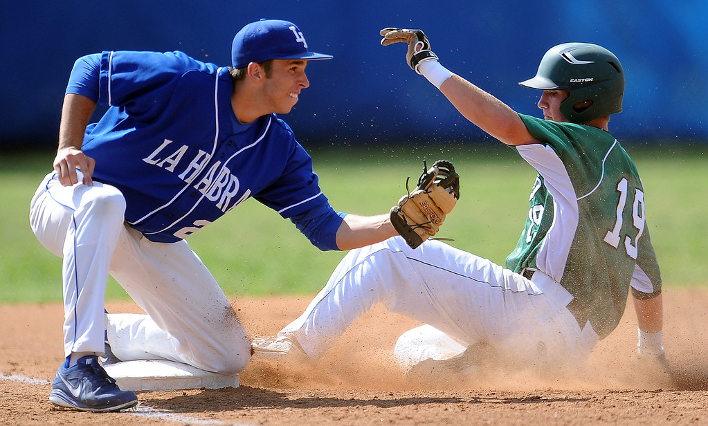 . Bonita\'s Joe Quire (19) safe ahead of the tag by La Habra third baseman Brett Mays in the first inning of a prep baseball game at La Habra High School on Tuesday, April 2, 2013 in La Habra, Calif. Bonita won 8-2.  (Keith Birmingham Pasadena Star-News)