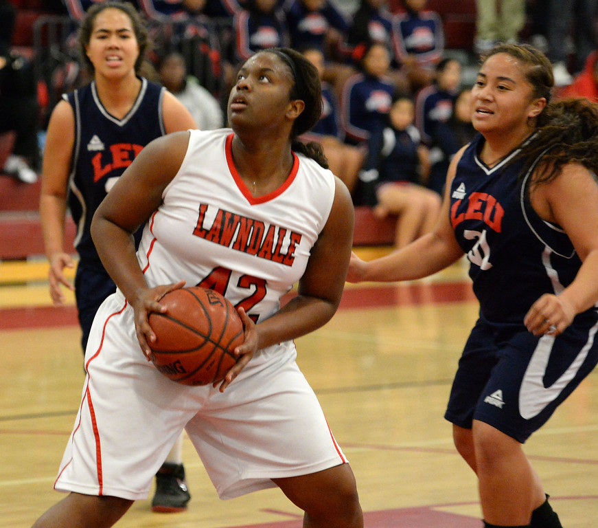 . Lawndale\'s Taylor Buffin (42) looks to shoot against Leuzinger in a girls basketball game at Lawndale High Tuesday, December 10, 2013, in Lawndale, CA.  Photo by Steve McCrank/DailyBreeze