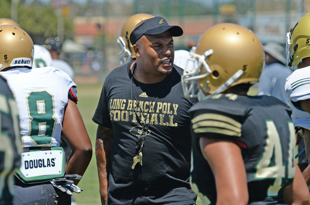 . Coach Antonio Pierce at Long Beach Poly football practice Saturday, August 16, 2014, Long Beach, CA.   Photo by Steve McCrank/Daily Breeze