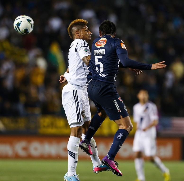 . Los Angeles Galaxy defender Sean Franklin, left, and Monterrey defender Darvin Chavez during the CONCACAF Champions League semifinal, Wednesday, April 3, 2013, in Carson, Calif. Monterrey won 2-1. (AP Photo/Bret Hartman)