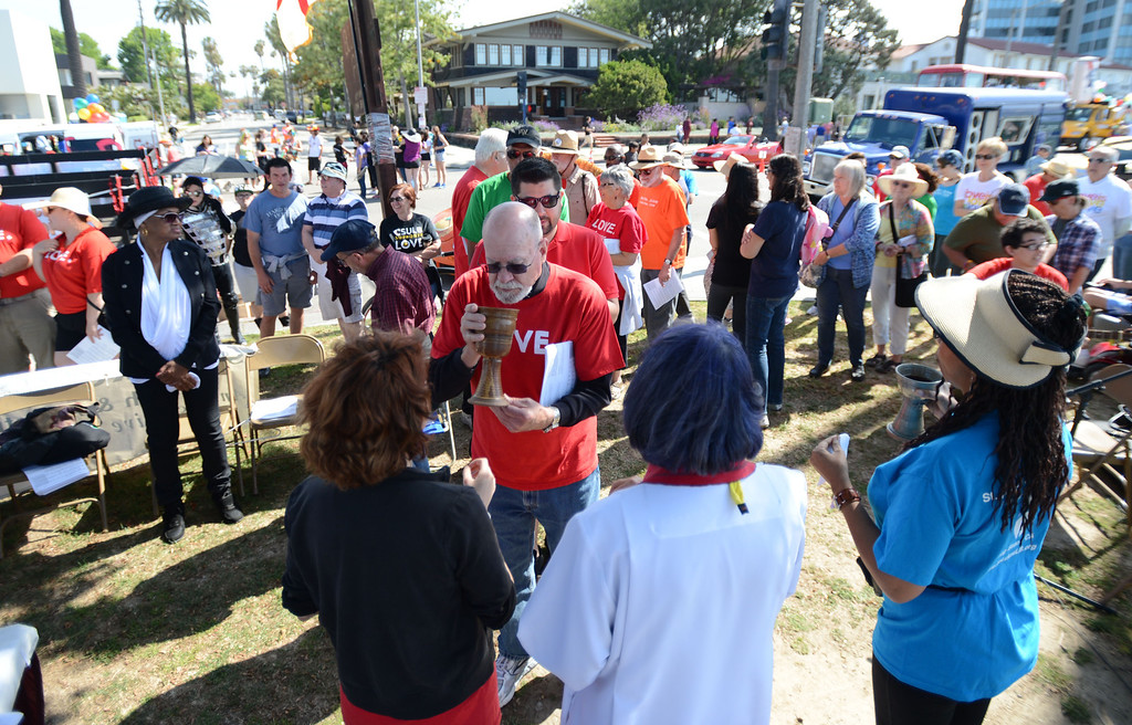 . Long Beach, Calif., -- 05-19-13- St. Luke\'s Episcopal Church held a communion ceremony in support of gay and lesbian rights Sunday morning on Bluff Park, ahead of the 30th Annual Long Beach Gay and Lesbian Pride Parade along Ocean Boulevard Sunday.    Stephen Carr/  Los Angeles Newspaper Group